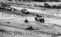 Operation Eilbote : halftracks of Kampfgruppe Lüder cross Oued Maarouf